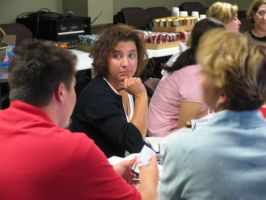 Cheyenne teacher K.C. Randolph participates with other teachers at a recent character training seminar, funding in part by two local business people. Photo by Jim Hulsey