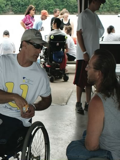 Two men having a conversation during SOURCES Fun Day event