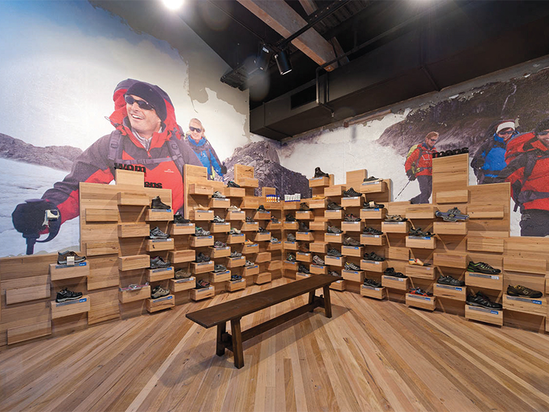 Shoe wall adding structural appeal to display area.