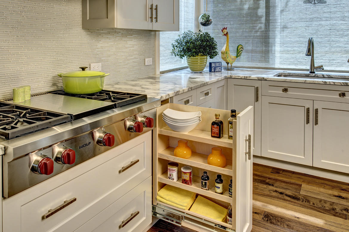 we placed pull out storage on either side of the range for easy access to frequently used spices oils condiments and hot pads - Unique Kitchen Storage Ideas