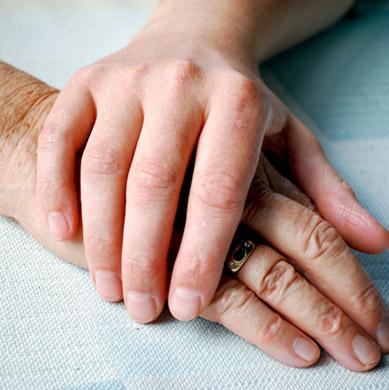 USMM nurse holding patient's hand