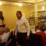 Samson Setu wanders amongst the diners