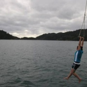 Sister number two Aysha (now 22) swinging of the boat for cold swim.