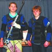 WHS student Scott Gray (right) proudly displaying the first new Anschutz .22 smallbore target rifle, RCP 5/5/16.