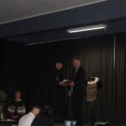 Tokararangi Poa being congratulated by Principal, Martin McAllen.