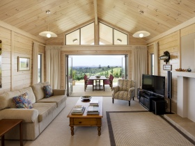 The guest lounge showing the view out to the deck and Mt Maunganui