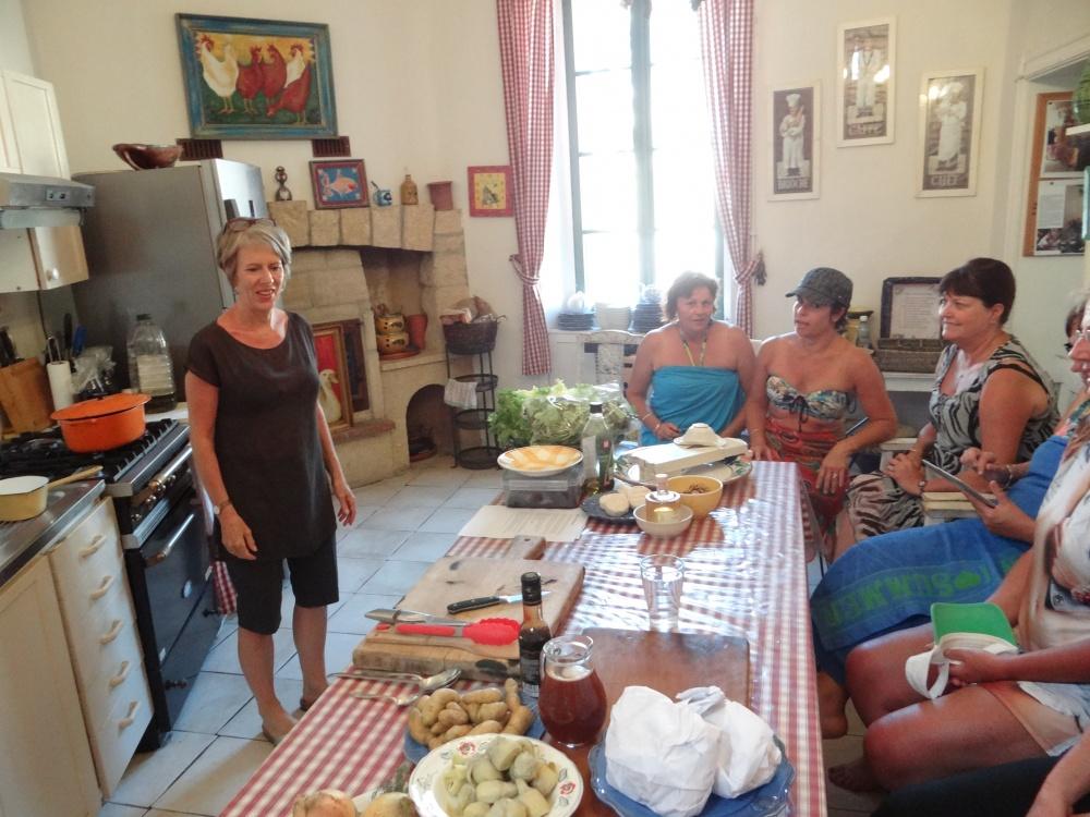Julia demonstrating in kitchen of Maison de Maitresse