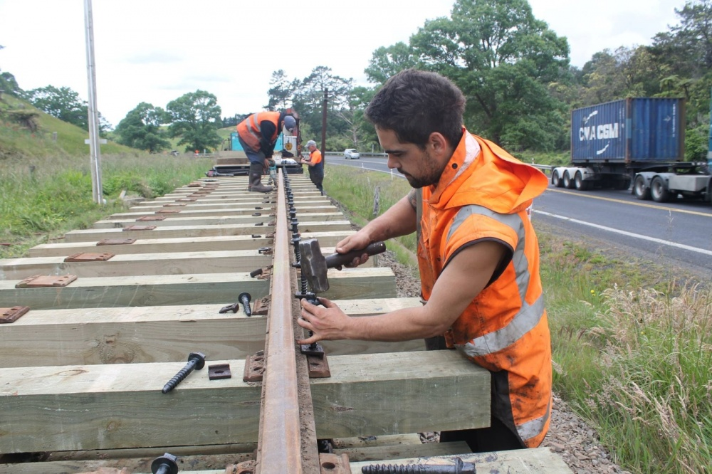 Goldfields railway ganger taps bolt into place.